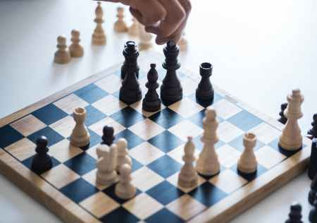white and black chessboard with pieces